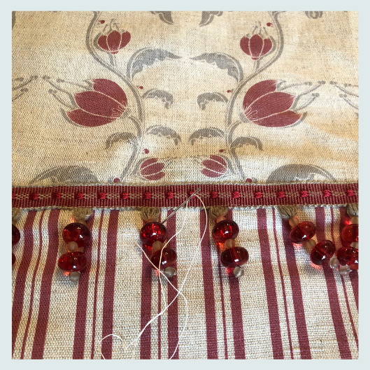 Bespoke handmade roman blinds, pattern matched and hand sewn trims