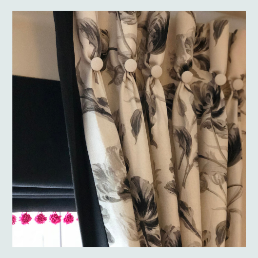 Handmade, bespoke, floral curtains, in hues of grey, goblet pleat heading with handmade contrast feature buttons