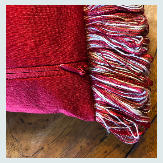 Red silk scatter cushions with a ribbon trim. Workshop ideas, about, is this course for me?