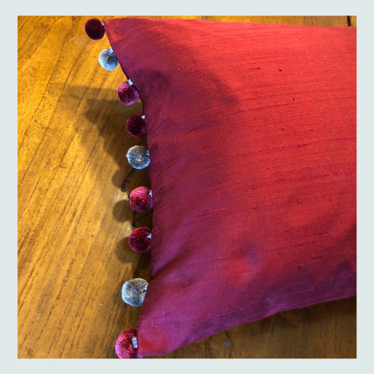 Red silk scatter cushion with a ribbon and pom pom trims. Workshop ideas, about, is this course for me?