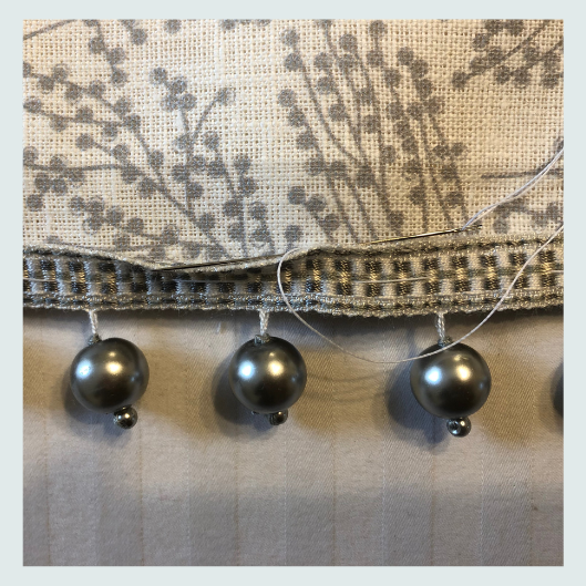 Work in progress. Hand stitching beaded trim.  Silver and cream linen scatter cushion with a Beaded trim and handmade buttons. Workshop ideas, about, is this course for me?