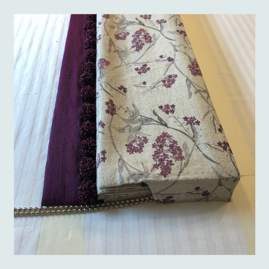 Bespoke handmade roman blinds, pattern matched and hand sewn trims, integral heading