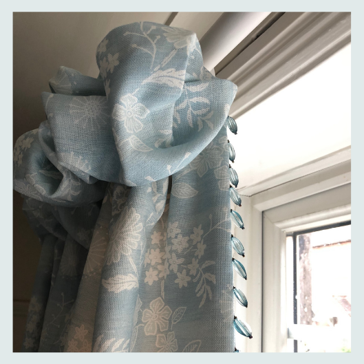 Handmade blue floral linen curtains, cottage top heading and beaded trim