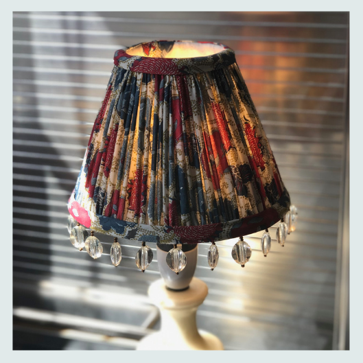 Bespoke handmade pleated/gathered lampshade with a beaded trim. Liberty tana lawn fabric in blues red and cream