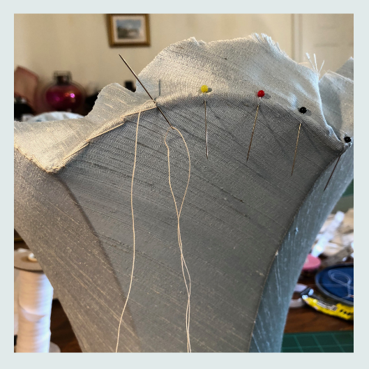 Lampshade stitch on the base of a commissioned bespoke handmade tailored lampshade in wedgewood blue dupion silk