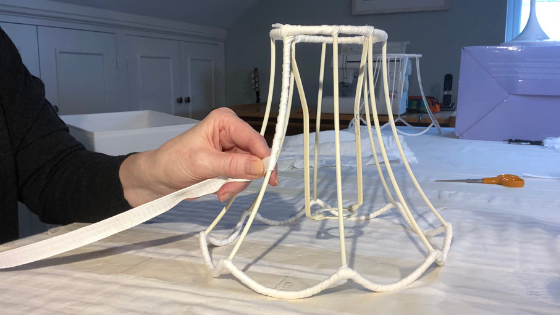 Binding a stripped vintage lampshade ready to make a template for a traditional handmade tailored lampshade