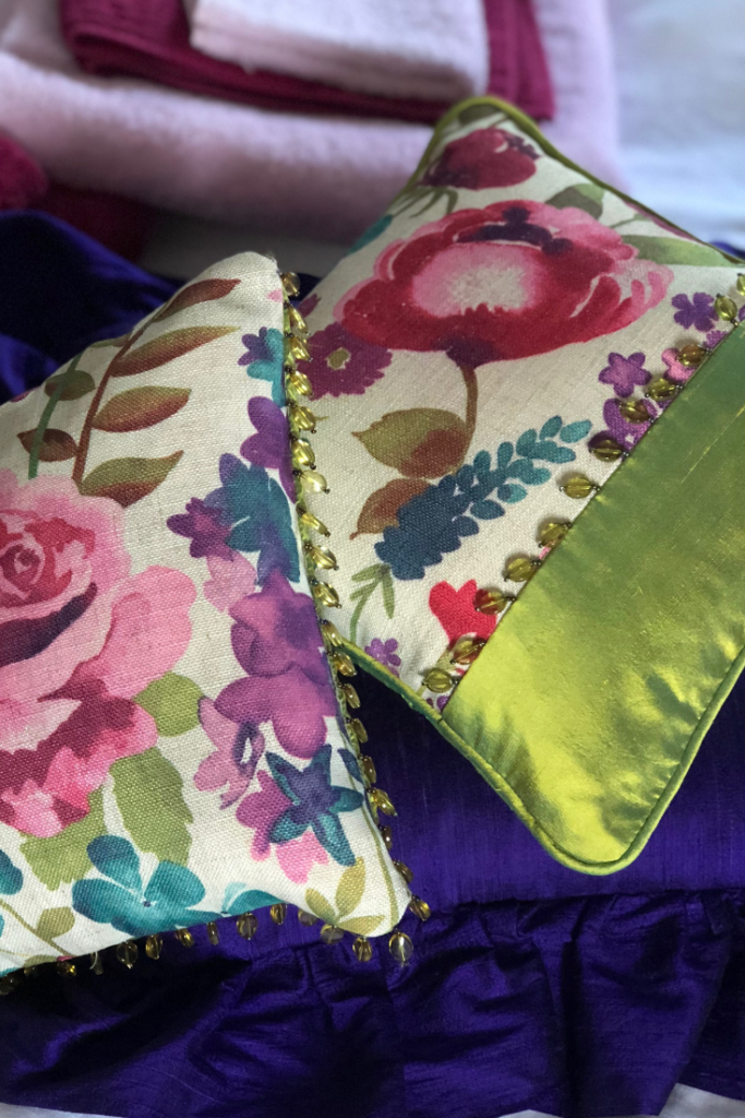 Scatter cushions in floral and green silks and linens with beaded trim ideas.